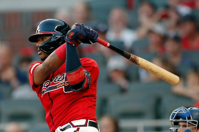 Atlanta Braves' Ronald Acuna Jr. drives in a run with a base hit in the second inning of a baseball game against the Los Angeles Dodgers, Friday, Aug. 16, 2019, in Atlanta. (AP Photo/John Bazemore)
