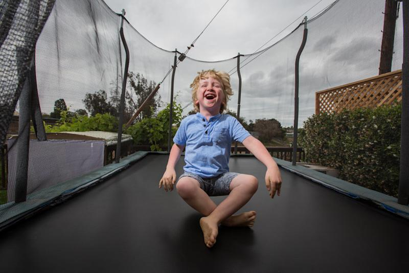 """Ian is a fun-loving boy who has<a href=""""https://ghr.nlm.nih.gov/condition/megalencephaly-capillary-malformation-syndrome"""" target=""""_blank"""">megalencephaly-capillary malformation syndrome</a> (MCAP) and <a href=""""https://ghr.nlm.nih.gov/condition/polymicrogyria"""" target=""""_blank"""">polymicrogyria</a>(PMG), which involve the skin, connective tissue and brain causing a disproportionately large head and capillary malformations on the skin. (Karen Haberberg)"""