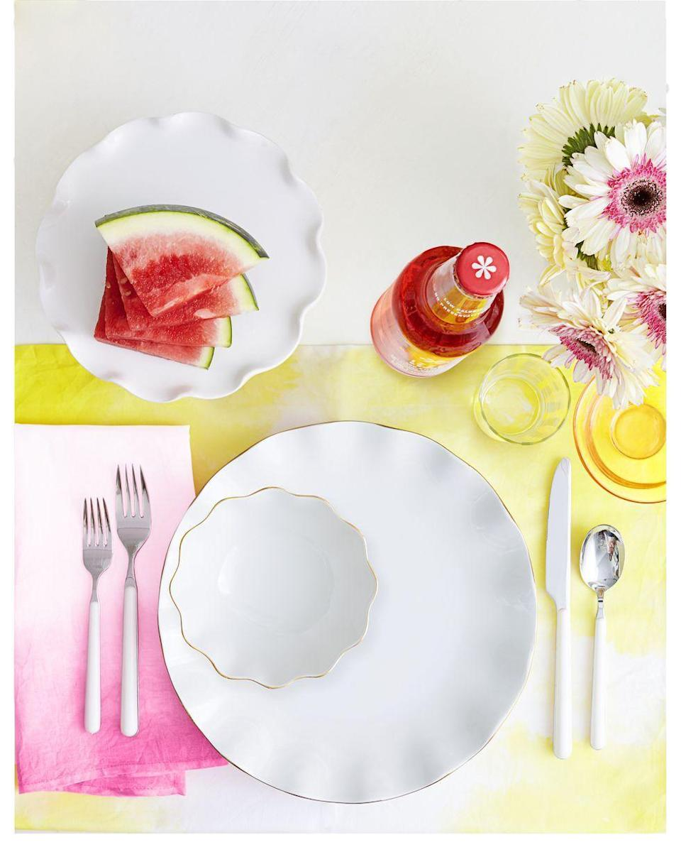 """<p>Bring bursts of color to your dining table by sticking plates and utensils on colorful ombre linens — napkins, place mats, table runners, and more. </p><p><em><a href=""""https://www.goodhousekeeping.com/home/craft-ideas/how-to/g2439/diy-dyed-napkins"""" rel=""""nofollow noopener"""" target=""""_blank"""" data-ylk=""""slk:Get the tutorial »"""" class=""""link rapid-noclick-resp"""">Get the tutorial »</a></em> </p>"""
