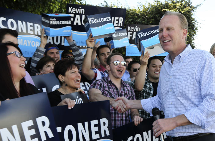San Diego mayoral candidate Kevin Faulconer shakes hands with his supporters outside his campaign headquarterss Tuesday, Feb. 11, 2014, in San Diego. Faulconer is facing fellow city commissioner David Alvarez in the race to replace disgraced mayor Bob Filner. (AP Photo/Lenny Ignelzi)