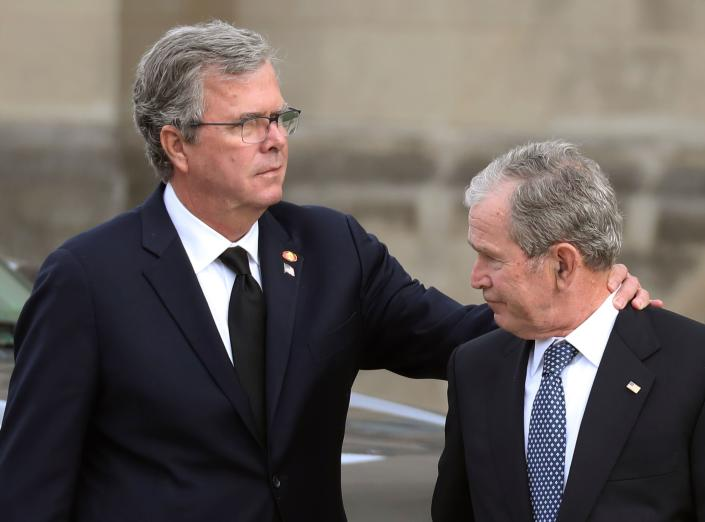 Former President George W. Bush (R) and his brother, former Florida Governor Jeb Bush, arrive for the funeral service for their father, former President George H. W. Bush, at the National Cathedral in Washington, Dec. 5, 2018. (Photo: Alex Edelman/AFP/Getty Images)