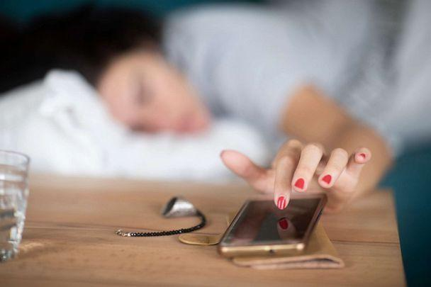 PHOTO: A person hits the snooze button on an alarm on their smartphone in an undated stock photo. (STOCK PHOTO/Getty Images)