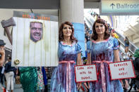 <p>Cosplayers dressed as <em>The Shining</em> twins at Comic-Con International on July 19, 2018, in San Diego. (Photo: Christy Radecic/Invision/AP) </p>