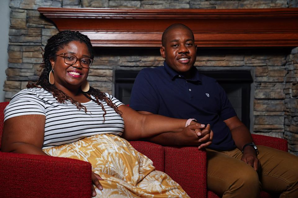 Erica and Aaron Parker, pictured, Tuesday, Aug. 31, 2021. They say the home they were trying to sell appraised higher when the removed all semblance that they were a Black family.