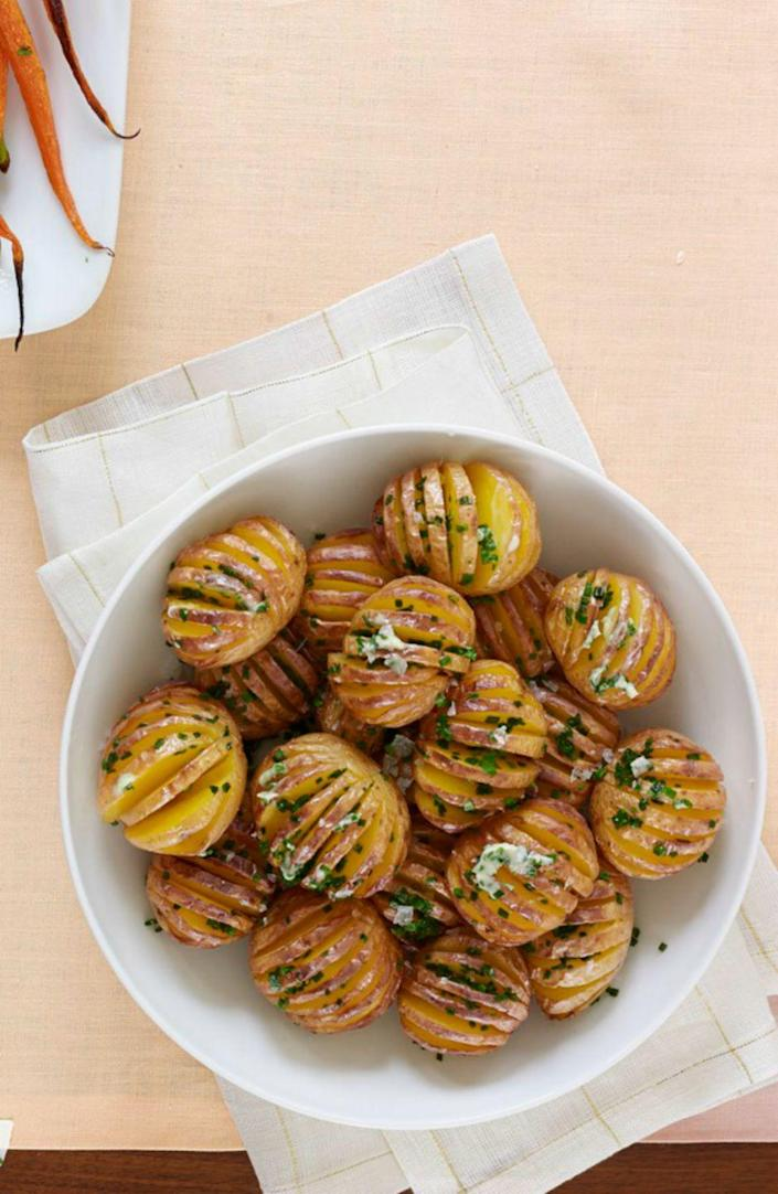 """<p><span>Just a few ingredients will get you this delicious, low-calorie side dish that tastes as good as it looks. </span></p><p><span><strong><em><a href=""""https://www.womansday.com/food-recipes/food-drinks/recipes/a53986/mini-hasselback-potatoes-with-chive-butter-recipe/"""" rel=""""nofollow noopener"""" target=""""_blank"""" data-ylk=""""slk:Get the Mini Hasselback Potatoes with Chive Butter recipe"""" class=""""link rapid-noclick-resp"""">Get the Mini Hasselback Potatoes with Chive Butter recipe</a>.</em></strong><br></span></p>"""