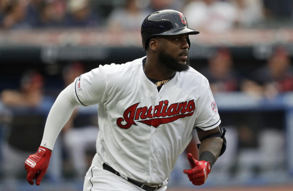Cleveland Indians' Franmil Reyes watches his two-run home run in the first inning of a baseball game against the Boston Red Sox, Monday, Aug. 12, 2019, in Cleveland. Carlos Santana also scored on the play. (AP Photo/Tony Dejak)