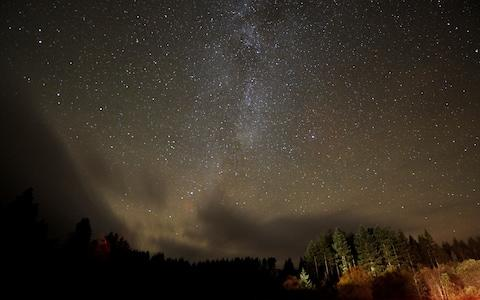 Stars in the Milky Way over Kielder Forest - Credit: Owen Humphreys