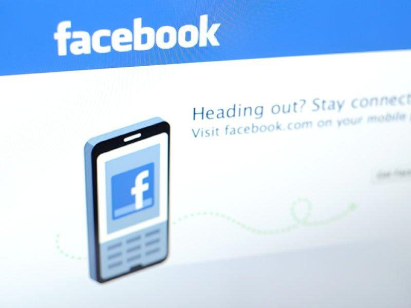 Facebook falls to half of public offering