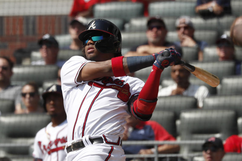 Atlanta Braves center fielder Ronald Acuna Jr. (13) follows through on a solo home run in the third inning of a baseball game against the Philadelphia Phillies Thursday, Sept. 19, 2019, in Atlanta. The homer was Acuna's 40th of the season. (AP Photo/John Bazemore)