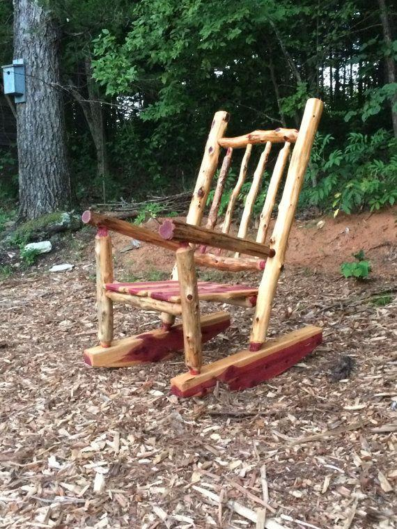 """Toss a throw pillow and woolen throw across this rocking chair, and it's the most inviting seat in the house. <a href=""""https://www.etsy.com/listing/252965168/rustic-cedar-log-rocking-chair-front"""" target=""""_blank"""">Shop it here</a>."""