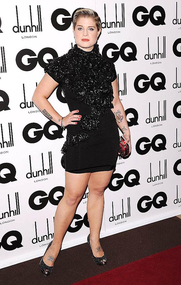 """Despite her overindulgence in tacky tattoos, """"Dancing With the Stars"""" contestant Kelly Osbourne was dressed to impress in an embellished turtleneck dress and studded Christian Louboutin peep-toe pumps at the 2009 GQ Men of the Year Awards in London. Solarpix/<a href=""""http://www.splashnewsonline.com"""" target=""""new"""">Splash News</a> - September 9, 2009"""