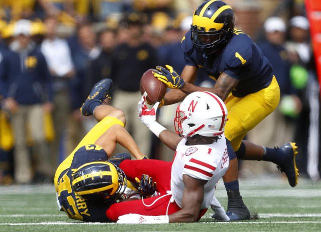 Michigan's Ambry Thomas (1) recovers a fumble by Nebraska Tyjon Lindsey (1) on a punt return after Jake McCurry (43) made the tackle in the first half of an NCAA football game in Ann Arbor, Mich., Saturday, Sept. 22, 2018. (AP Photo/Paul Sancya)