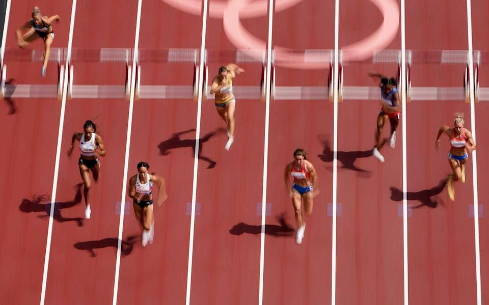 Katarina Johnson-Thompson, of Britain, wins her heat during a heat in the women's heptathlon 100-meter hurdles at the 2020 Summer Olympics, Wednesday, Aug. 4, 2021, in Tokyo. - AP