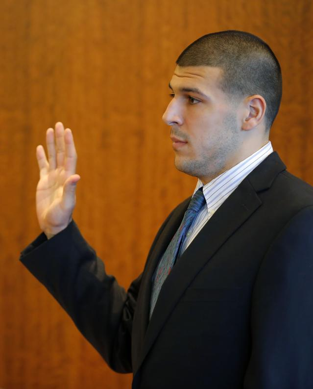 Aaron Hernandez, former player for the NFL's New England Patriots football team, takes an oath to tell the truth before being questioned by Judge Susan Garsh during a court appearance at the Bristol County Superior Court in Fall River, Massachusetts October 9, 2013, in connection with the death of semi-pro football player Odin Lloyd in June. Hernandez, who was a rising star in the NFL before his arrest and release by the Patriots, has pleaded not guilty. REUTERS/Brian Snyder (UNITED STATES - Tags: CRIME LAW SPORT FOOTBALL)