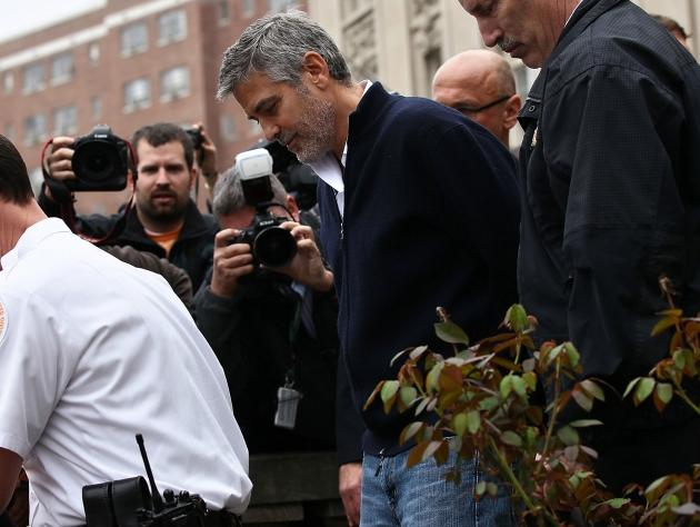 George Clooney is arrested during a demonstration outside the Embassy of Sudan in Washington, D.C. on March 16, 2012 -- Getty Images