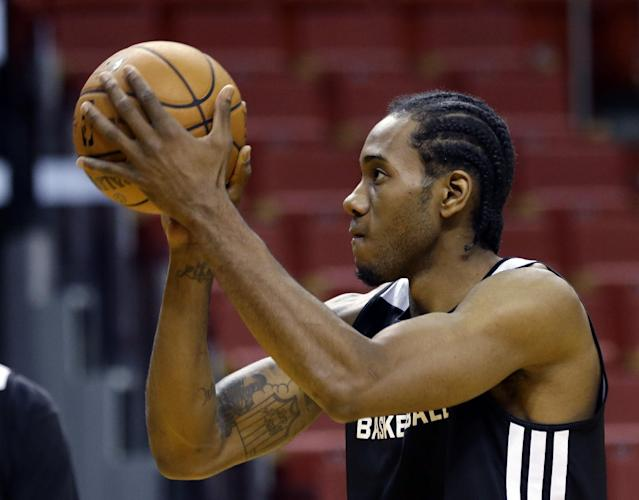 San Antonio Spurs' Kawhi Leonard shoots during basketball practice at the NBA Finals Wednesday, June 11, 2014, in Miami. The Spurs lead the Miami Heat 2-1 in the best-of-seven games series. (AP Photo/Lynne Sladky)