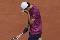 Austria's Dominic Thiem reacts as he plays Spain's Pablo Andujar during their first round match of the French Open tennis tournament at the Roland Garros stadium Sunday, May 30, 2021 in Paris. (AP Photo/Christophe Ena)