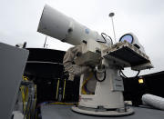 <p> In this July 30, 2012 photo provided by the U.S. Navy, a laser weapon sits temporarily installed aboard the guided-missile destroyer USS Dewey in San Diego. The Navy plans to deploy its first laser on a ship in 2014, and intends to test an electromagnetic rail gun prototype aboard a vessel within the following two years. (AP Photo/U.S. Navy, John F. Williams) </p>