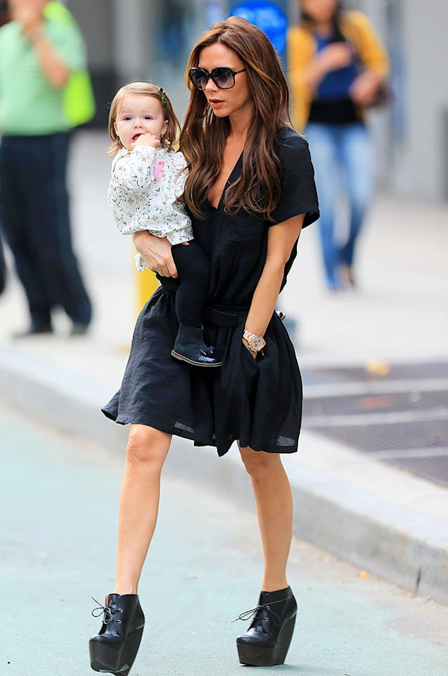 And last but not least we have Victoria Beckham, who was spotted out and about in the Big Apple earlier this week with baby Harper in tow. In addition to her adorable accessory, Posh sported an amazing, short-sleeved Balenciaga dress, extreme Lanvin wedges, and her signature gold Rolex. (10/23/2012)