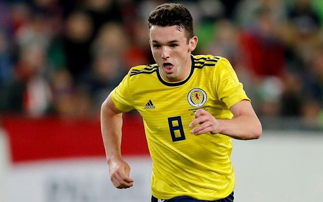 John McGinn has a year left on his Hibs contract but would only leave for something better - Getty Images Europe