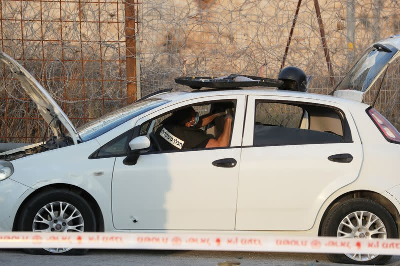 Israeli police sapper works inside a vehicle at the scene of what Israeli police said was an attempted car-ramming attack at a checkpoint in East Jerusalem