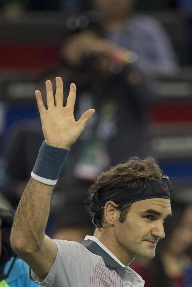 Switzerland's Roger Federer celebrates winning the match against Italy's Andreas Seppi for the Shanghai Masters tennis tournament at the Qizhong Forest Sports City Tennis Center in Shanghai, China, Wednesday Oct 9, 2013. Federer won 6-4, 6-3. (AP Photo/Ng Han Guan)