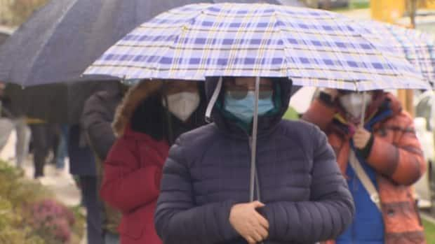 People form a line in Langley, B.C., on Saturday hoping to purchase a townhome. (Doug Kerr/CBC News - image credit)