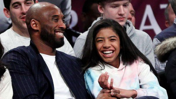 PHOTO: Retired NBA star Kobe Bryant and his daughter Gigi, watch an NBA basketball game, Dec. 21, 2019, at Barclays Center in New York City. (Paul Bereswill/Getty Images, FILE)