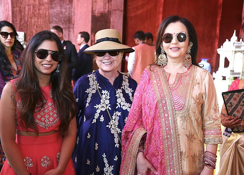 "This handout photograph released on December 9, 2018 by Reliance Industries shows Reliance Industries chairman wife Nita Ambani (R), with her daughter Isha Ambani along with former US first lady Hillary Clinton (C) posing for a picture at Swadesh Bazaar in Udaipur. (Photo by Handout / Reliance Industries / AFP) / RESTRICTED TO EDITORIAL USE - MANDATORY CREDIT ""AFP PHOTO / RELIANCE INDUSTRIES"" - NO MARKETING NO ADVERTISING CAMPAIGNS - DISTRIBUTED AS A SERVICE TO CLIENTS --- NO ARCHIVE ---HANDOUT/AFP/Getty Images ORIG FILE ID: AFP_1BG76X"