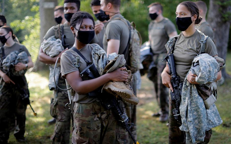 U.S. Military Academy (USMA) cadets wear protective face masks as they gather their gear after training - REUTERS/Mike Segar