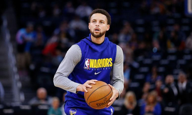 Golden State Warriors point guard Steph Curry warms up.