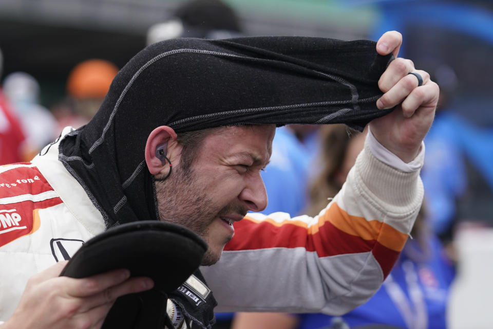 Marco Andretti pulls off his balaclava during qualifications for the Indianapolis 500 auto race at Indianapolis Motor Speedway, Saturday, May 22, 2021, in Indianapolis. (AP Photo/Darron Cummings)