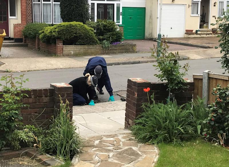 Police search the area surrounding the woman's Romford home (PA)