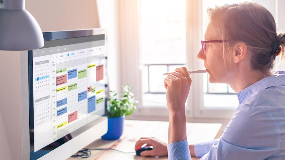 Person using calendar on computer to improve time management, plan appointments, events, tasks and meetings efficiently, improve productivity, organize week day and work hours, business woman, office.
