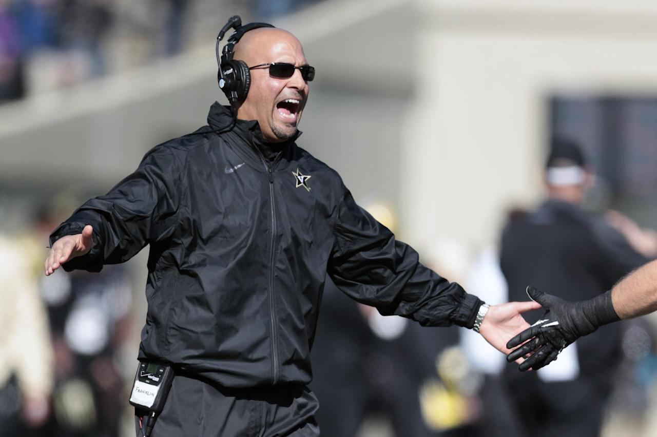 Vanderbilt head coach James Franklin congratulates players after a touchdown against Wake Forest in the first quarter of an NCAA college football game on Saturday, Nov. 30, 2013, in Nashville, Tenn. (AP Photo/Mark Humphrey)