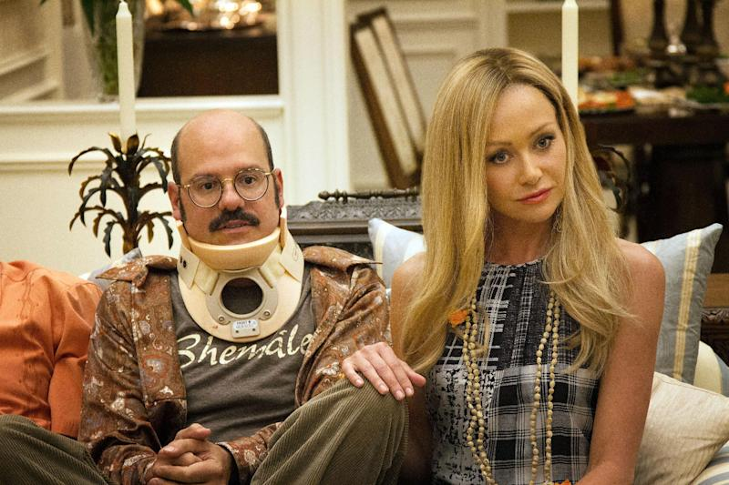 "This undated publicity photo released by Netflix shows David Cross, left, and Portia de Rossi in a scene from ""Arrested Development,"" premiering May 26, 2013 on Netflix. The sitcom, also starring Jason Bateman and Will Arnett, was canceled by Fox in 2006 after three seasons. (AP Photo/Netflix, Sam Urdank)"