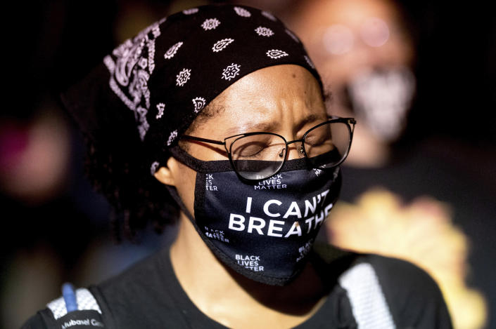 Black Lives Matter protester Synnamon, who declined to give a last name, rallies at the Mark O. Hatfield United States Courthouse on Saturday, Aug. 1, 2020, in Portland, Ore. Following an agreement between Democratic Gov. Kate Brown and the Trump administration to reduce federal officers in the city, nightly protests remained largely peaceful without major confrontations between demonstrators and officers. (AP Photo/Noah Berger)