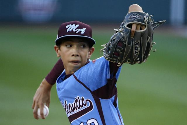 Philadelphia pitcher Jared Sprague-Lott delivers during the first inning of a baseball game against Pearland at the Little League World Series tournament in South Williamsport, Pa., Sunday, Aug. 17, 2014. (AP Photo/Gene J. Puskar