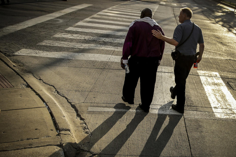 FILE - This photo from Wednesday June 3, 2020, shows Kansas City Police Chief Rick Smith, right, and Bishop Tony Caldwell, left, walking away for a private chat, during protests against police brutality in Kansas City, Mo., following the death of George Floyd in Minneapolis. The chaos unleashed in 2020, amid the coronavirus pandemic, has created space for different voices to speak, for different conversations to be had and for different questions to be asked. (AP Photo/Charlie Riedel, File)