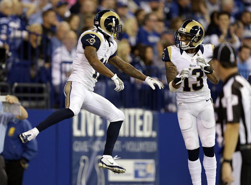 St. Louis Rams wide receiver Tavon Austin, left, celebrates with wide receiver Chris Givens after scoring a touchdown against the Indianapolis Colts during the first half of an NFL football game in Indianapolis, Sunday, Nov. 10, 2013. (AP Photo/Darron Cummings)