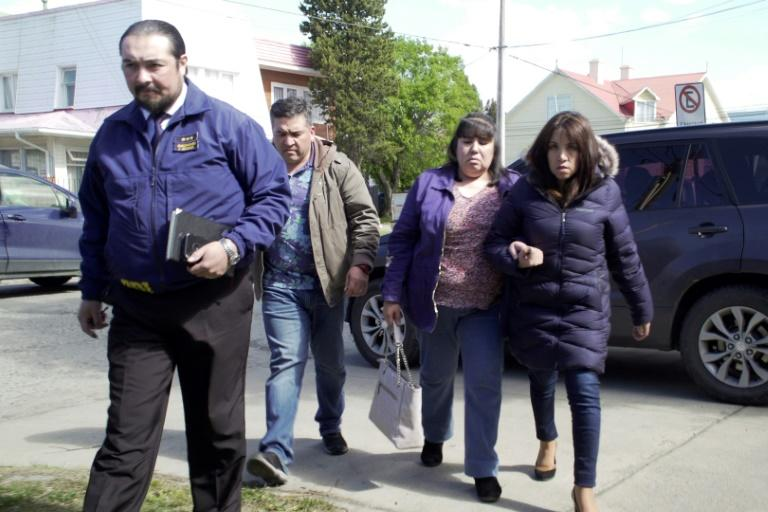 Relatives of the crash victims are photographed in Punta Arenas, Chile, on December 12, 2019