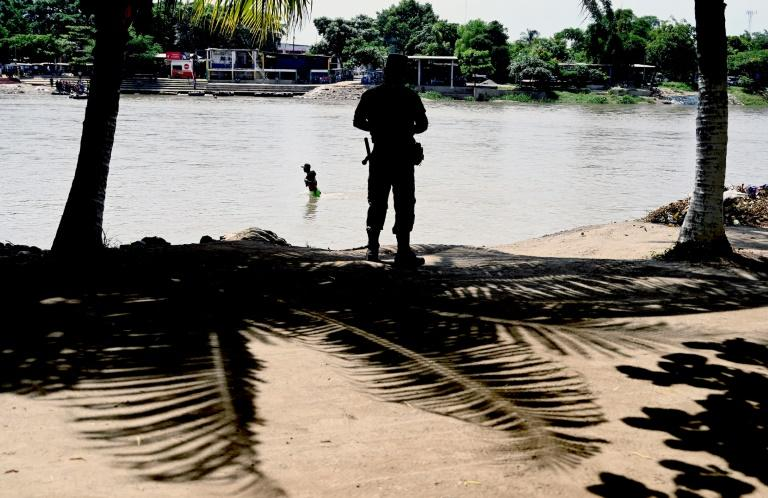 A member of the Mexican National Guard patrols the banks of the Suchiate River in Chiapas State, Mexico, in July 2019 in an effort to prevent illegal migrant crossings