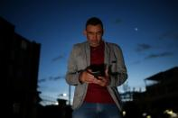Matias Gutierrez, a former professional soldier, speaks during an interview with Reuters in Bogota