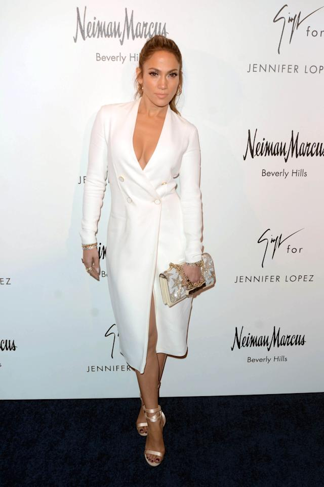 <p>Jennifer rocked a plunging white button-up coat the only way J Lo can. Her satin Giuseppe Zanetti sandals were the perfect finishing touch. <i>[Photo: Rex]</i> </p>