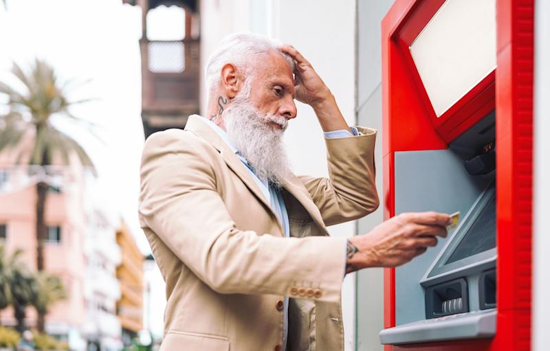 Happy mature man withdraw money from bank cash machine with debit card - Senior male doing payment with credit card in ATM - Concept of business, banking account and lifestyle people