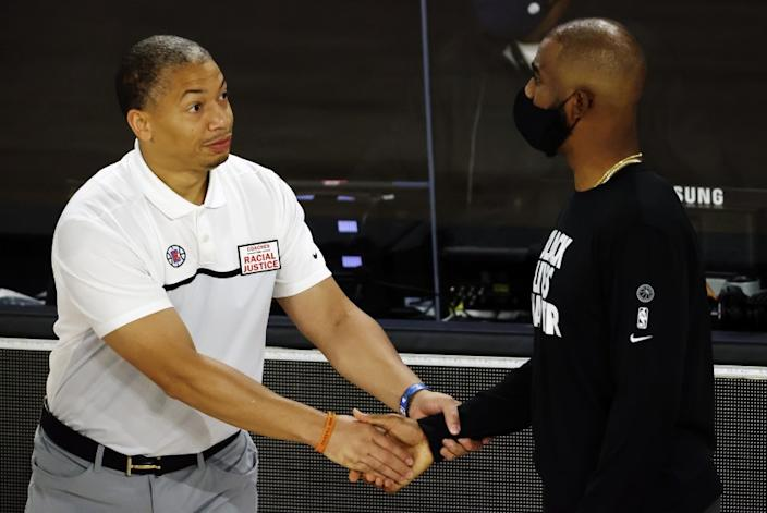 Los Angeles Clippers assistant coach Tyronn Lue, left, shakes hands with Oklahoma City Thunder's Chris Paul during the first quarter of an NBA basketball game Friday, Aug. 14, 2020, in Lake Buena Vista, Fla. (Mike Ehrmann/Pool Photo via AP)