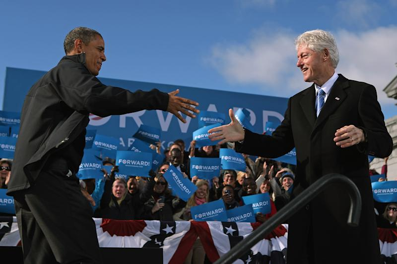 """CONCORD, NH - NOVEMBER 04:  U.S. President Barack Obama (L) is welcomed to the stage by former President Bill Clinton during a campaign rally in State Capitol Square November 4, 2012 in Concord, New Hampshire. With only two days left until the presidential election, Obama and his opponent, former Massachusetts Gov. Mitt Romney are stumping from one """"swing state"""" to the next in a last-minute rush to persuade undecided voters.  (Photo by Chip Somodevilla/Getty Images)"""