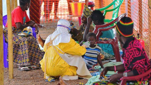 PHOTO: An MSF medical worker feeds an Ebola child victim at an MSF facility in Kailahun, on Aug. 15, 2014. (Carl De Souza/AFP/Getty Images)