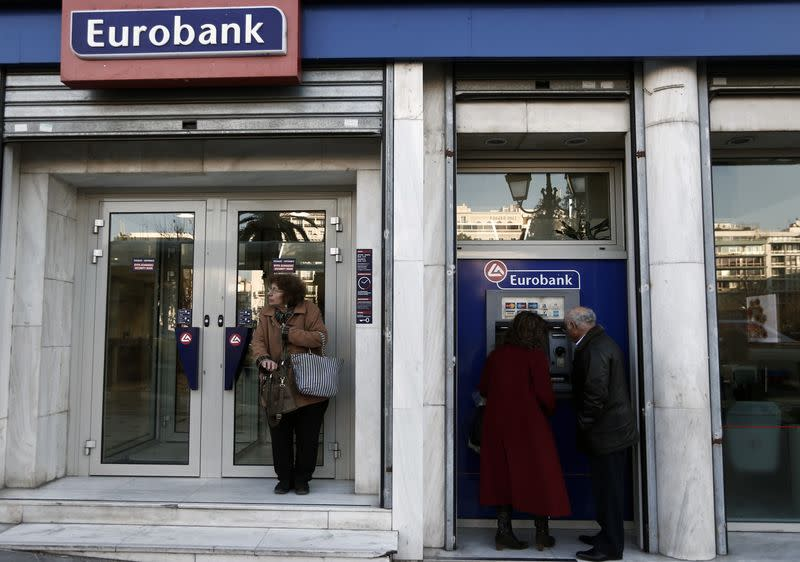 People are seen outside a Eurobank branch in Athens