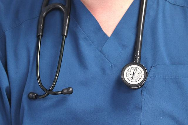 File photo dated 15/08/14 of a doctor with a stethoscope around their neck. Low morale and poor pay are key reasons why the NHS struggles to retain staff, according to a new survey.